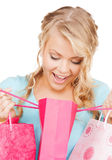 Picture of happy woman with shopping bags Royalty Free Stock Photos