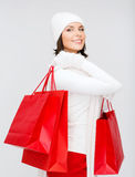 Picture of happy woman with shopping bags Royalty Free Stock Image