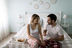 Picture of of happy young couple spending morning together. Picture of happy young couple spending morning together in bedroom Stock Photo