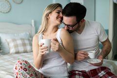 Picture of of happy young couple spending morning together. Picture of happy young couple spending morning together in bedroom Stock Photography