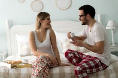 Picture of of happy young couple spending morning together. Picture of happy young couple spending morning together in bedroom Stock Photos