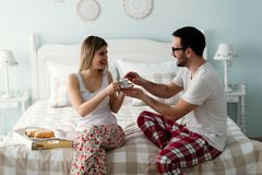 Picture of of happy young couple spending morning together. Picture of happy young couple spending morning together in bedroom Royalty Free Stock Photo