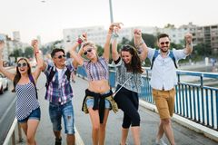 Picture of happy young friends hanging out together stock images