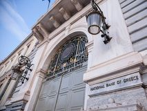 Main entrance of the National Bank of Greece, the central bank of the country, at dusk. stock photography