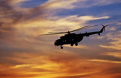 Picture of helicopter at sunset. Silhouette of helicopter Royalty Free Stock Photo