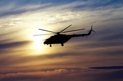 Picture of helicopter at sunset. Silhouette of helicopter on sun Royalty Free Stock Image