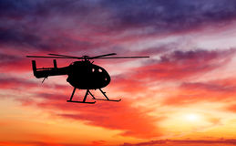Picture of helicopter at sunset. Stock Photo