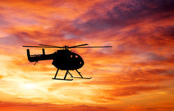 Picture of helicopter at sunset. Royalty Free Stock Photo