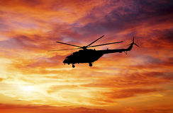 Picture of helicopter at sunset. Stock Images