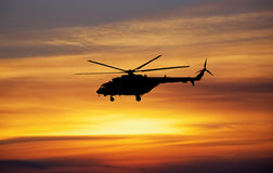 Picture of helicopter at sunset. Royalty Free Stock Image