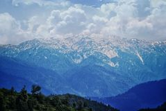 Picture of a himalayan mountain with snow and clouds on it royalty free stock images