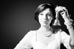 Picture of holding bell in hand beautiful young Royalty Free Stock Photography