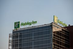 Holiday Inn logo on their main hotel in Serbia. Holiday Inn is a worldwide brand of hotels, part of the InterContinental Group. Picture of the Holiday Inn sign stock image