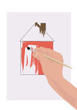 Picture house. A hand with a brush risuyuschey house Stock Photo