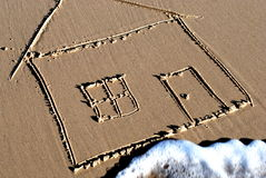 Picture of a house drawn in the sand Royalty Free Stock Images