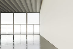 Picture of huge expo hangar in modern building. Expo interior loft style with concrete floor,panoramic windows.Abstract royalty free stock photography
