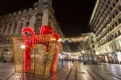 Giant gift wrap used as the main Christmas decoration on Kneza Mihailova, main street of Belgrade, illuminated for Xmas and NYE. Picture of a huge gift pack on Royalty Free Stock Photography