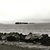 A photo from Treasure Island facing Alcatraz with shipping container ship in landscape stock photos