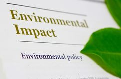 Environmental Impact. Picture illustrating the environmental impact and environmental policy of corporate sector and companies through the annual report as a Royalty Free Stock Photo