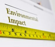 Environmental Impact. Picture illustrating measuring environmental impact and environmental policy of corporate sector and companies through the annual report as Stock Photo