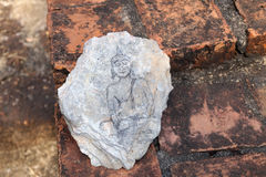 Picture. Image Buddha statue on a piece of stone Stock Photos