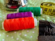 Sewing items - colorful thread, buttons, measuring tape, needles Stock Image