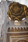 Minaret. Mihrab. The Great Mosque or Mezquita famous interior in Cordoba, Spain. The Picture of the interior Great Mosque currently Catholic cathedral. UNESCO stock photography