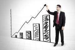Italian businessman drawing growth chart Stock Photo