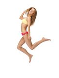 Picture of jumping woman in bikini. Bright picture of jumping woman in bikini Royalty Free Stock Photos