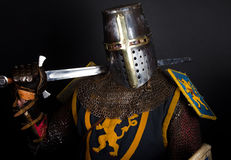 Picture of knight. Mighty knight is holding a sword Stock Images
