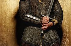Picture of a knight hands holding a sword Royalty Free Stock Photography