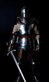Picture of knight in heavy armour Royalty Free Stock Images