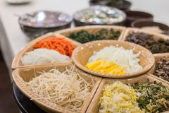 A picture of Korean Traditional food. The traditional food is served in a circular plate stock photography