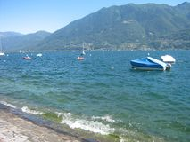 A lake during summer. A picture of a lake during summer where people go in to the water for swimming and boating taken on a vacation in Switserland Stock Photos