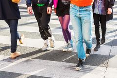 Legs of a crowd of people on the pedestrian crossing Royalty Free Stock Photos
