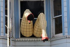 Legs with nylons sticking out of a window in San Francisco California stock photos