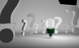 Picture of light bulb among question marks Royalty Free Stock Image