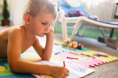Picture of little boy drawing with crayons Royalty Free Stock Images