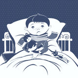The picture of the little boy with a sore throat wrapped in a scarf, lying in bed. Stock Photo