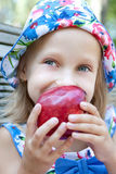 Picture of little girl with red apple Royalty Free Stock Photography