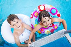 Picture of little kids enjoying in swimming pool Stock Photo