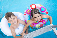 Picture of little kids enjoying in swimming pool Royalty Free Stock Photos