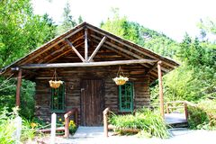 Log cabin in the woods. A picture of a log cabin in the woods in the summer stock photography