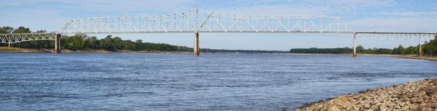 A picture of a long bridge reaching across Mississippi river stock photo
