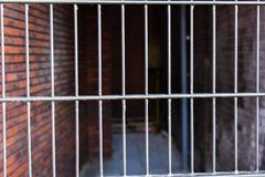 Grey Metal Fence Gate See-Through Chalk Orange White Stone Brick Blurry Pipe Background stock photography