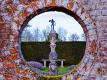 The Secret Garden - the unseen reality. A picture looking through into a secret garden of a statue - Polesden Lacy, Surrey, England stock photography