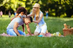 Picture of lovely couple with their daughter having picnic Royalty Free Stock Photos