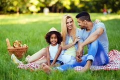 Picture of lovely couple with their daughter having picnic. In nature Stock Photo