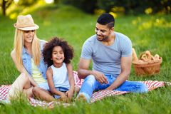 Picture of lovely couple with their daughter having picnic Stock Image