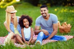 Picture of lovely couple with their daughter having picnic Royalty Free Stock Images